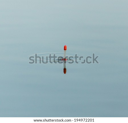 float for fishing on the water - stock photo