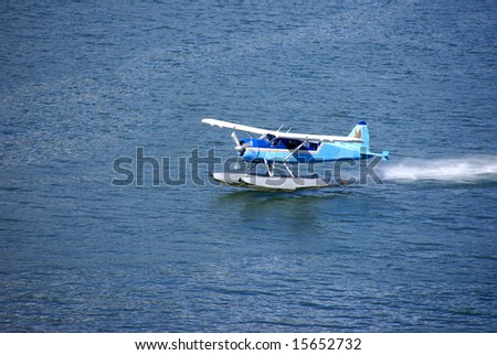 Float plane, taking off from water,		Juneau,	Alaska - stock photo