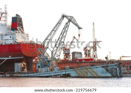 Floating cargo crane and part of cargo ship at the shipyard docks.Terminal in Riga. Outdoors. - stock photo