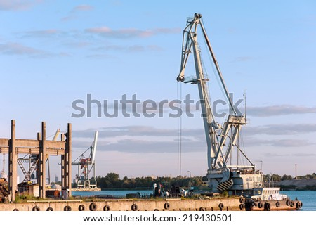 Floating cargo crane on barge near quay. Mooring in Riga. Outdoors. - stock photo