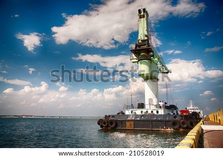 Floating Crane moored in the seaport. - stock photo
