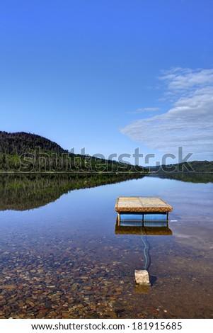 floating Dock at lake - stock photo