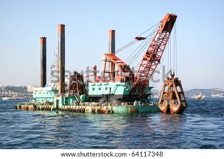 Floating dredging platform on the sea - stock photo