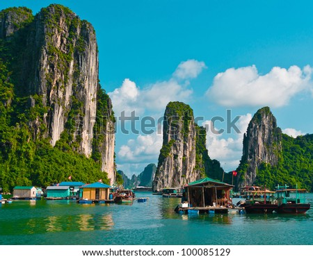 Floating fishing village in Halong Bay, Vietnam, Southeast Asia - stock photo