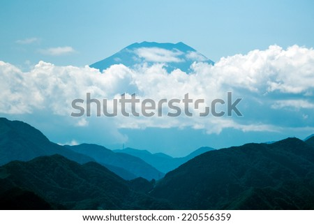 Floating Fuji. The summit of Mount Fuji floating above the clouds. Viewed from Mount Takao, Japan. - stock photo
