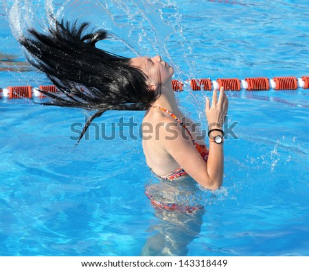 Floating girl at swimming pool in region Liptov, Slovakia