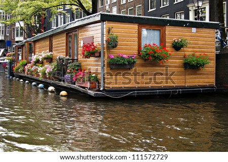 Floating house at Amsterdam - stock photo