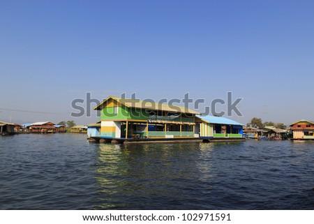 Floating house on the Kwai river Kanjanburi, Thailand - stock photo
