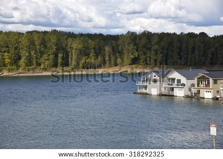 Floating houses and isolated island columbia River Oregon. - stock photo