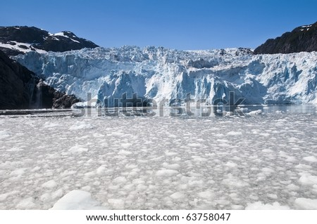 Floating ice in the Kenai Fjords National Park on a clear sunny day - stock photo