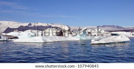 floating iceberg near Iceland shore - stock photo