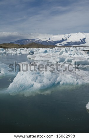 floating icebergs at Glacier Lagoon - stock photo