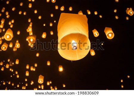 floating lantern which is a large balloon.The word �Yee Peng� is the northern Thai term referring to the full moon of the 12th lunar month in the Buddhist calendar.  - stock photo