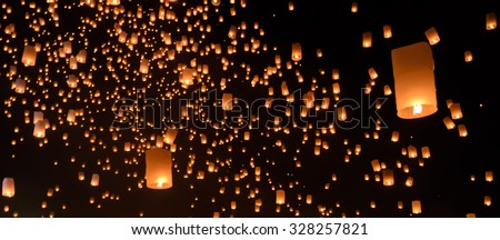 Floating lanterns ceremony or Yeepeng ceremony, traditional Lanna Buddhist ceremony in Chiang Mai, Thailand - stock photo