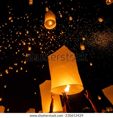 Floating lanterns during Yi Peng Festival in Chiang Mai, Thailand - stock photo