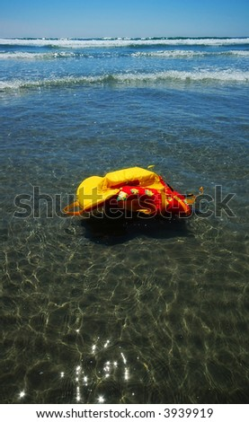 Floating life vest in a calm sea on a sunny day - stock photo