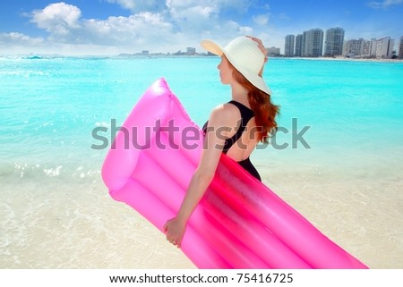 floating lounge pink girl in Cancun caribbean tropical beach Mexico [Photo Illustration]