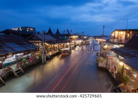 Floating market at night in Amphawa, Samut Songkhram , Thailand. - stock photo