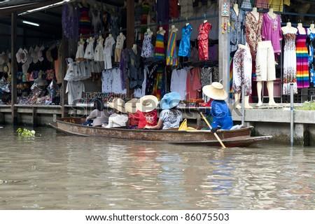 Floating Market customers - stock photo
