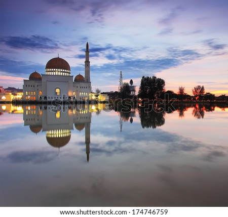 Floating Mosque at sunrise/sunset - stock photo