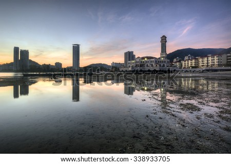 Floating mosque of Tanjung Bungah in Penang, Malaysia with reflection in the beach during low tide - stock photo