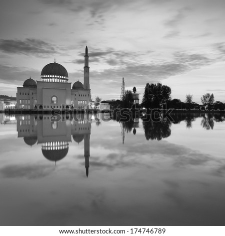 Floating mosque on black and white - stock photo