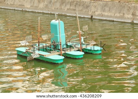 Floating paddle wheel aerator, water quality improvement machine, to fill or transfer oxygen into water, oblique view