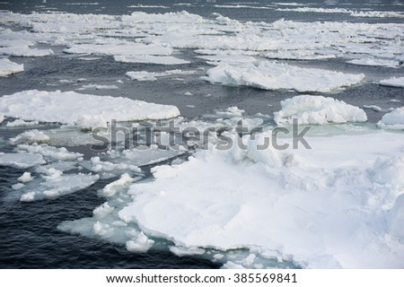 Floating pieces of the Abashiri ice drift in cold ocean near Hokkaido Japan - stock photo