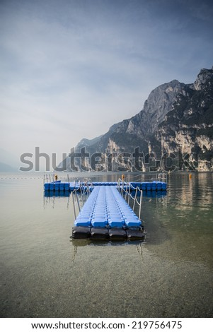 floating platform island for swimmers  - stock photo