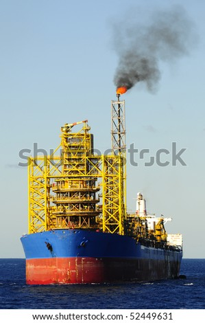 "Floating production storage and offloading ""FPSO"" oil rig in offshore area in the coast of Brazil. - stock photo"