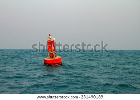 Floating red navigational buoy on blue sea,gulf of Thailand. - stock photo