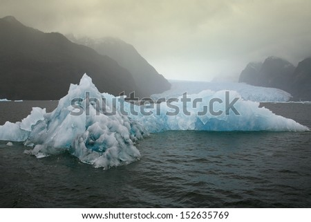 Floating sea ice near the San Rafael Glacier (in background) in southern Chile - stock photo