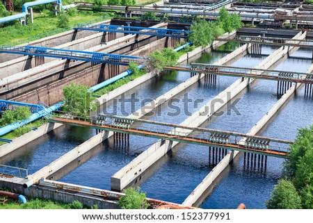 Floating surface aerators on sewage treatment plant - stock photo