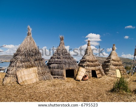 Floating Uros Island on Lake Titicaca in Peru - stock photo