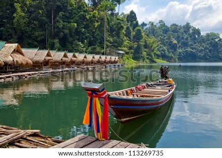 Floating village for tourists on the lake Cheo Lan in Thailand. - stock photo