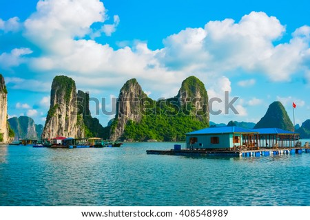 Floating village near rock islands in Halong Bay, Vietnam, Southeast Asia. UNESCO World Heritage Site. - stock photo