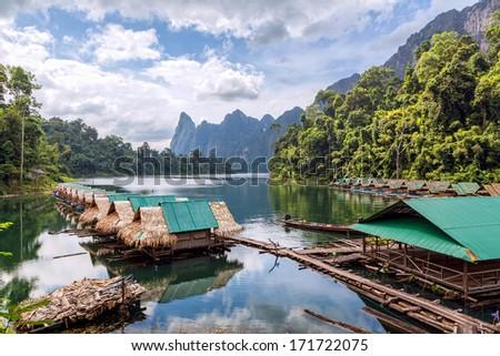 Floating village on Lake Cheo lan in Thailand - stock photo