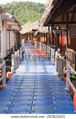 Floating walkway in resort - stock photo