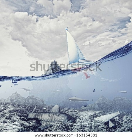 Floating yacht and dolphins swimming in water above sunken city - stock photo