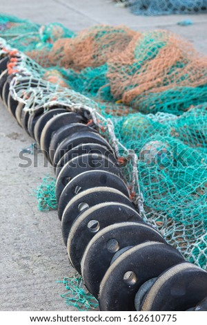 floats and nets on the quay at Whitby - stock photo