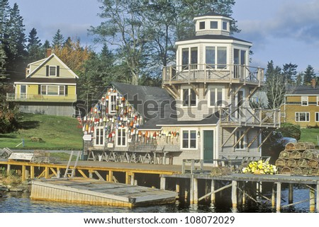 Floats from fishing nets hang on the side of a lighthouse in Stonington, Mount Desert Island, Maine