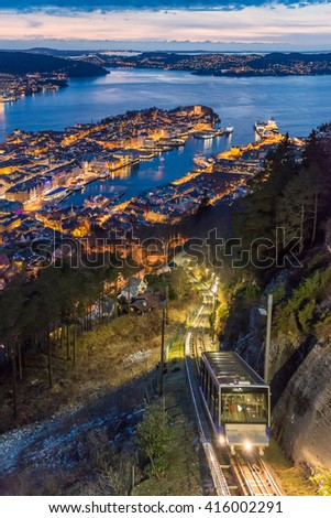 Floibanen funicular to Mt Floyen at Bergen City, Scenic Aerial View Panorama harbour Cityscape under Dramatic Sky at sunset summer from Top of Mount Floyen Glass Balcony Viewpoint mountain in Norway  - stock photo