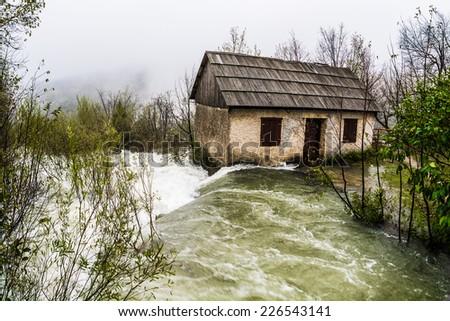 Flood, abandoned house washed away - stock photo