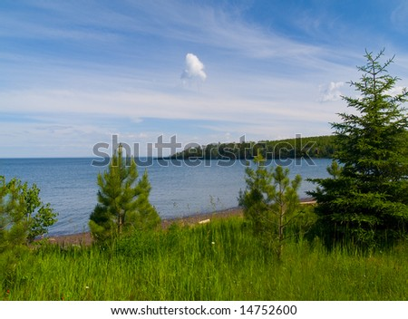 Flood Bay along the North shore of Lake Superior overlooking young evergreens. - stock photo