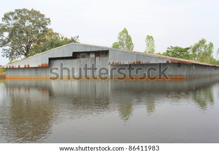 Flood.Flood old warehouse. - stock photo