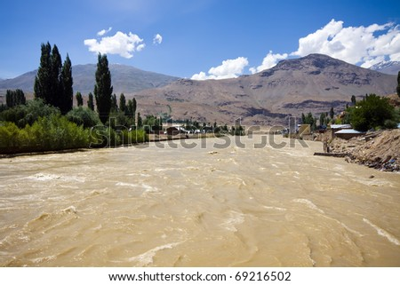 Flood in populated area in Pamir - stock photo