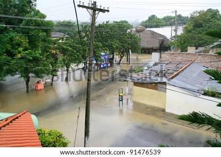 Flood in tropical city - stock photo