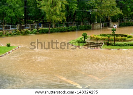 Flood on the road after heavy rain in city of Thailand - stock photo