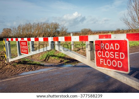 Flood Road Closed Warning Sign on Road Barrier - stock photo