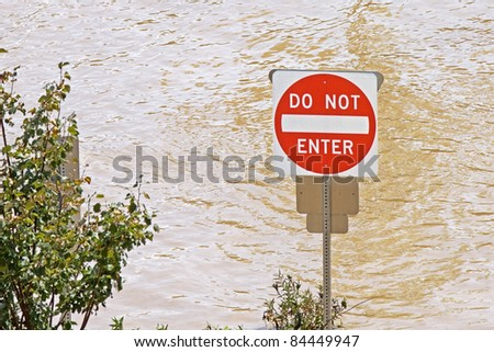Flood waters from a hurricane cover a parking area - stock photo